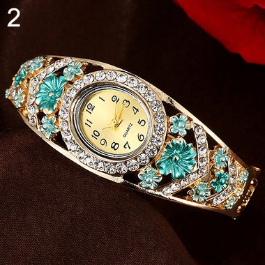 Girl's Flower Rhinestone Ellipse Dial Hollow Bangle Quartz Casual Wrist Watch [S