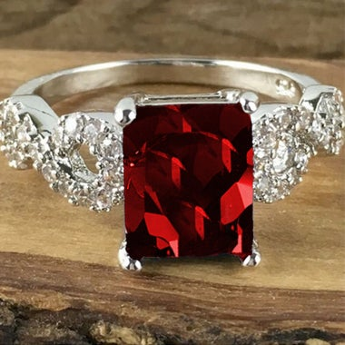 Emerald-Cut Brilliant 4 Carat AAA Zirconia Gem set in a White Gold Infinity Band