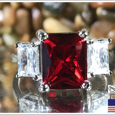 Garnet on .925 Silver Band. Sizes 7,8 or 9 only please