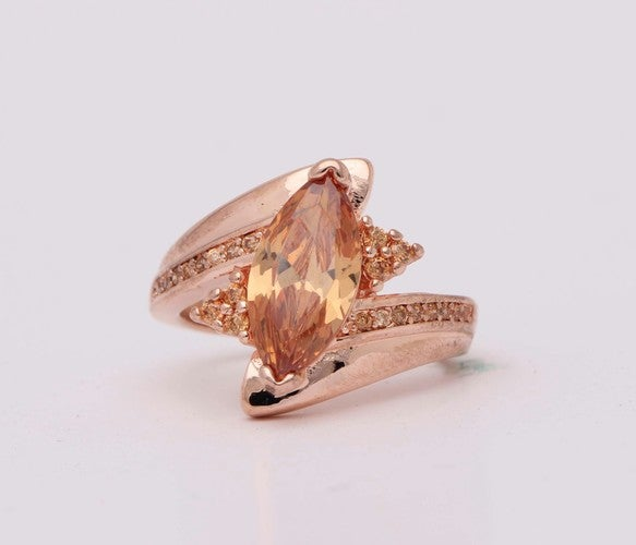 Rose gold plated marquis cut wedding engagement ring.