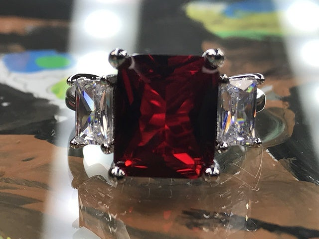 Garnet on Silver Band. Sizes 7,8 or 9 only please