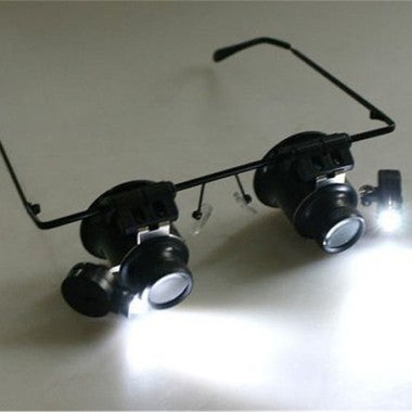 Eyeglasses double head with lamp trimmings for special magnifying glass
