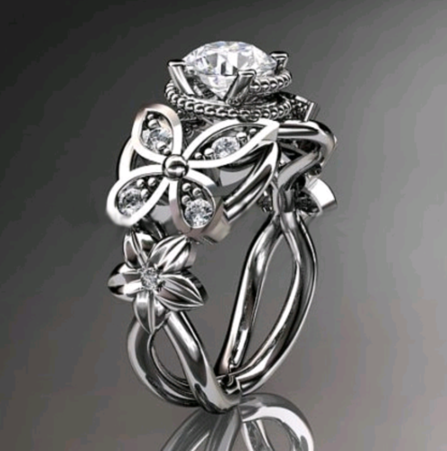 WGP flower and butterfly wedding engagement ring.