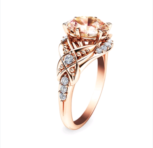 Rose gold plated champagne stone and rhinestone wedding engagement ring.