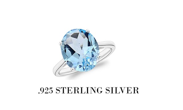 .925 Sterling Silver Ring W/ Oval Lab Created  Blue Topaz Stone