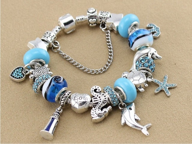 New arrival!!!!! Gorgeous bracelet with one of the kind beads. Very bright and rich colors.Silver plated. Exellent for the summer. The one you don't want to missout on!!!!!!