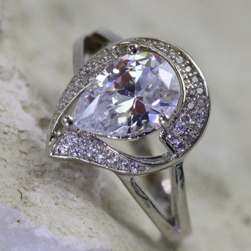 """""""Millennium"""" collection from Alpha Jewelry. 100% Genuine ring. 3.25 CT Pear Shape main stone inlay with 35 5AAAAA quality luxury white zircon. Certified Three times Platinum plated. Excellent quality. Excellent cut, excellent clarity. Very rich looking"""