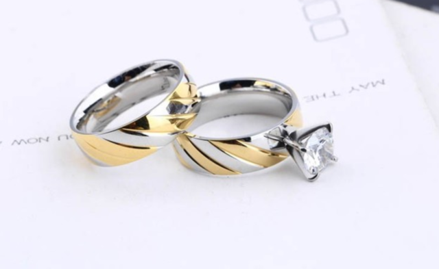Stainless steel two toned wedding engagement set.