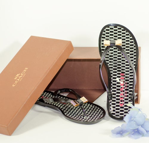 5a6b2d6922d58 NIB Coach Landon Jelly Black Shiny Sandals Flip Flops Gold Metalic Bow Size  7. 1 5