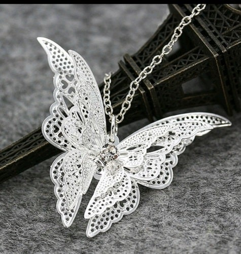 gorgeous finely detailed 3D silver butterfly necklace