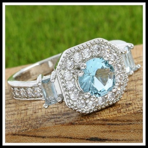 Beautifully Created Fine Sky Blue Topaz & White Sapphire Ring Sm9070
