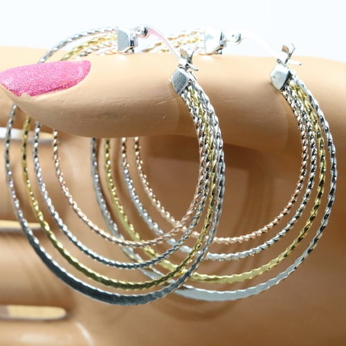High quality earrings for women. Three tone finish. Never fade technology. Sophisticated design and rich look. You will be happy with them.