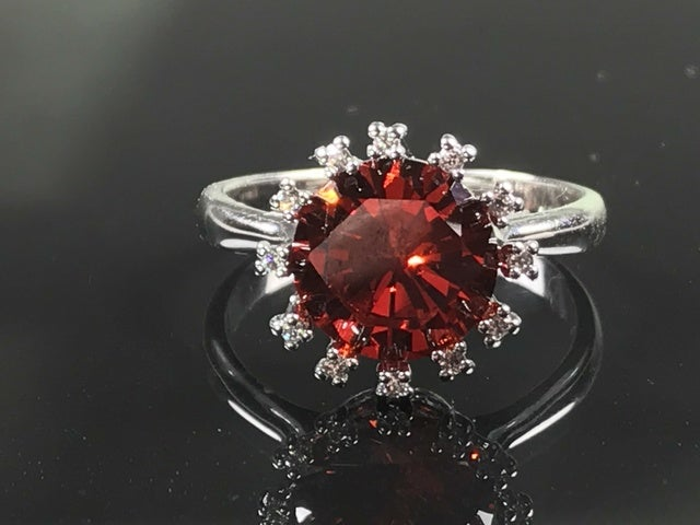 Fiery Red Crown on Rhodium Plated Ring.
