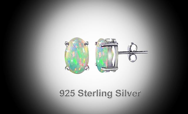 .925 Sterling Silver Stunnig Lab Crerated Opal Stud Earings 7x5