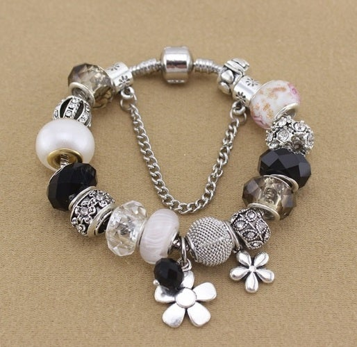 New arrival!!! Statement bracelet with a great beads selection. Very nice blend of colors and quality. First and ever Pearl bead (option with a metal flower attachment)!!!! Exclussively from Alpha jewelry.