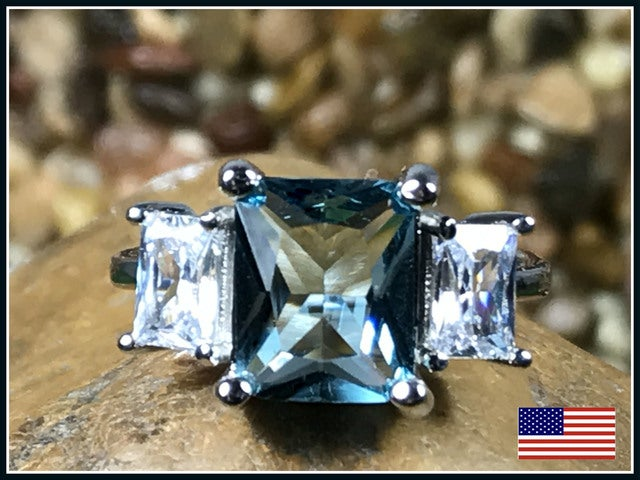 Blue Cubic Zirconia on Silver Band. Sizes 7,8 or 9 only please
