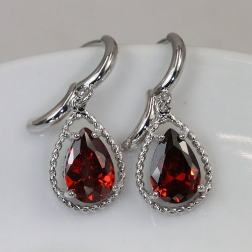 Elegant. Rich. Luxurious deep Natural Zircons!!!! Very sharp looking earrings but still elegant and classy. Platinum plated. Superior quality and lots of happy clients