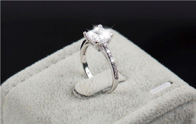 Classy, square shape main stone ring. 2.45Ct main stone. 5AAAAA grade Genuine Italian Zircon. Super shiny and rich looking ring. Certified 3x Platinum plated.