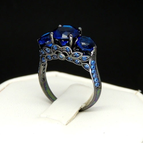 Brilliant 3 stone Black and Blue Ring